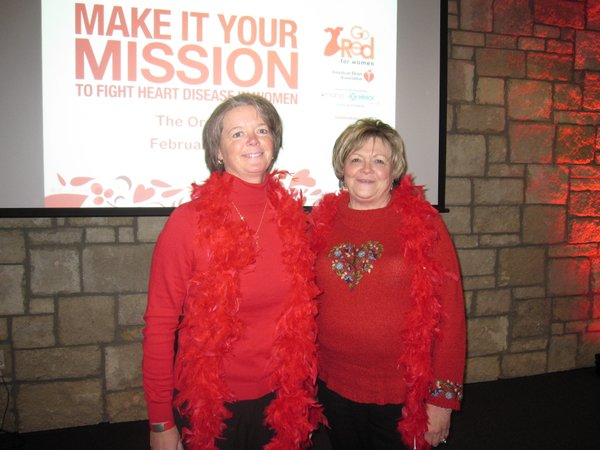 Michelle Derusseau, Lawrence, and her mother Sue Lavery, Lenexa, attend the Go Red For Women luncheon, Friday, Feb. 11, 2011, at The Oread Hotel. Derusseau, 47, was the passion speaker during the event. She suffered a heart attack at age 39 in April 2003.