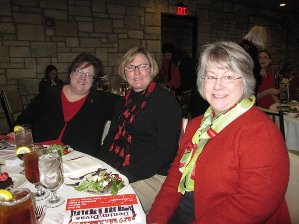From left are Amanda Rolfs, Overland Park, Linda Griffin, Lawrence, and Susan Hitz, Overland Park. They attended the Go Red For Women luncheon, which raised about $30,000 for the American Heart Association.