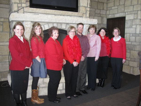 From left are Cindy Hart, Ali Edwards, Janet Mihalchik, Debi Waggoner, Tyler Lindquist, Tamara Hand, Amy Phalen and Monica Taylor. They attended the Go Red For Women Luncheon on Friday, Feb. 11, 2011, at The Oread Hotel. They sat at the table sponsored by WellCommons.