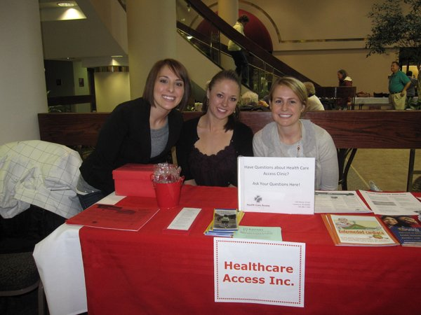 From left are Heather Schwind, Laura Quenette and Jackie Burton, all interns for the wellness program at Health Care Access, a clinic that provides medical care for the uninsured of Douglas County. They provided information about wellness and the clinic during the Healthy Hearts Fair on Saturday, Feb. 12, 2011, at Lawrence Memorial Hospital, 325 Maine.
