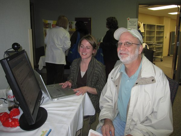 Monica Taylor, left, and Chris Edmondson, Lawrence, visit about WellCommons.com, a community-based health website, during the Healthy Hearts Fair at LMH. Taylor works in marketing at the Lawrence Journal-World.