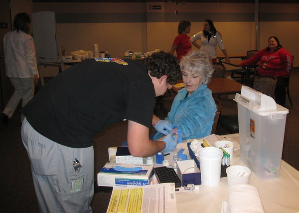Taylin Hein, Lawrence Memorial Hospital medical technologist, withdraws blood from Roberta Malburg, of Linwood, for a cholesterol screening during the Healthy Hearts Fair earlier this year. LMH's annual Health Fair will be Sept. 24.