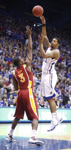 Kansas forward Markieff Morris dumps a pass over Iowa State guard Melvin Ejim during the first half on Saturday, Feb. 12, 2011 at Allen Fieldhouse.