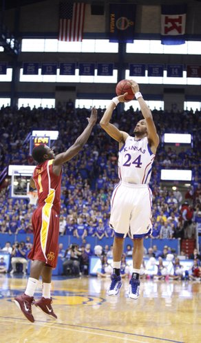 Kansas guard Travis Releford goes up for a three-pointer before being fouled by Iowa State guard Bubu Palo during the second half on Saturday, Feb. 12, 2011 at Allen Fieldhouse.