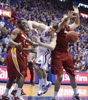 Kansas center Jeff Withey comes crashing through Iowa State defenders Darion Anderson, left, and Jordan Railey during the second half on Saturday, Feb. 12, 2011 at Allen Fieldhouse.