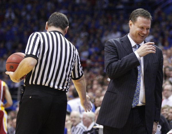 Kansas head coach Bill Self laughs after catching an errant pass from his guard Elijah Johnson during the second half on Saturday, Feb. 12, 2011 at Allen Fieldhouse.