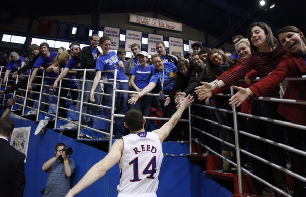 Kansas University students and fans align the stairs to slap hands with Tyrel Reed as he leaves the court following the Jayhawks' 89-66 win over Iowa State on Saturday, Feb. 12, 2011 at Allen Fieldhouse.
