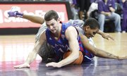 Kansas guard Tyrel Reed falls on a loose ball with Kansas State guard Rodney McGruder during the first half on Monday, Feb. 14, 2011 at Bramlage Coliseum.