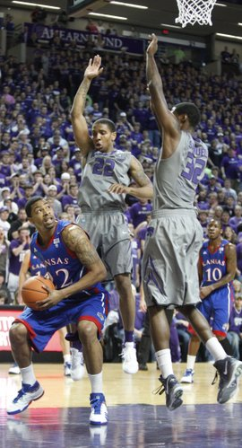 Kansas forward Marcus Morris looks to the bucket under Kansas State defenders Rodney McGruder (22) and Jamar Samuels (32) during the first half on Monday, Feb. 14, 2011 at Bramlage Coliseum.