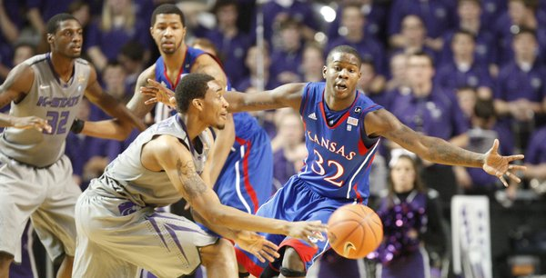 Kansas guard Josh Selby extends to defend a pass by Kansas State guard Shane Southwell during the first half on Monday, Feb. 14, 2011 at Bramlage Coliseum.
