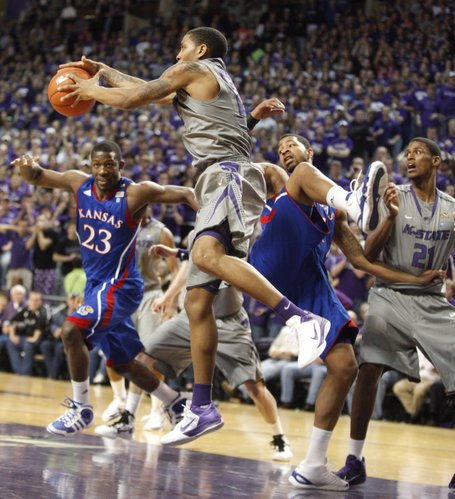 Kansas State forward Rodney McGruder pulls a rebound from Kansas players Mario Little (23) and Markieff Morris during the second half on Monday, Feb. 14, 2011 at Bramlage Coliseum.