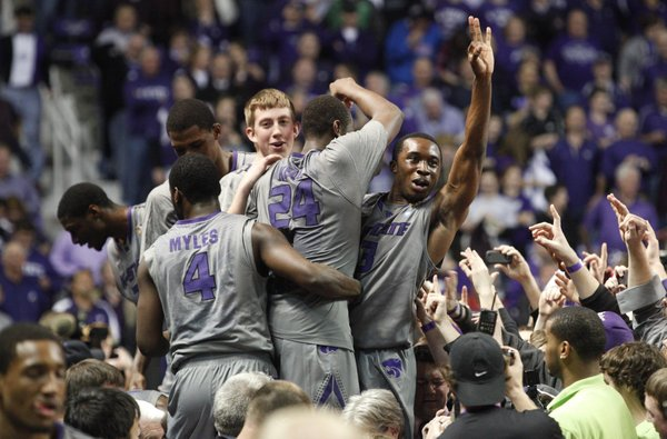 The Kansas State Wildcats celebrate on the scorer's table after defeating Kansas on Monday, Feb. 14, 2011 at Bramlage Coliseum.
