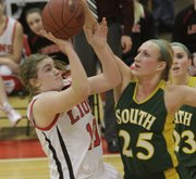 Lawrence High senior Emily Peterson shoots over Shawnee MIssion South's Emmy Allenon on Tuesday, February 15, 2011 at LHS.