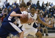 Bishop Seabury freshman Marcus Allen (3) defends Heritage junior Paul Muzzy on Tuesday, Feb. 15, 2011 in Lawrence.