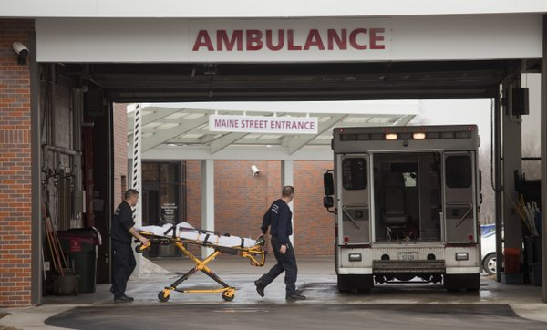 Emergency personnel reload an ambulance after bringing a patient to Lawrence Memorial Hospital on Wednesday, Feb. 16, 2011.