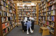 Anne Jacobson, of Glendale, Ariz., reads inside the Borders store in downtown Lawrence Wednesday, Feb. 16, 2011. Borders announced Wednesday that the Lawrence store at 700 N.H. will be one of several stores nationally to close by the end of April.