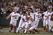 South Carolina baseball players celebrate after winning the College World Series in this file photo from June 29, 2010, in Omaha, Neb.