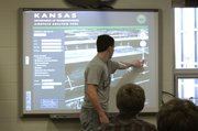 Alex Whitten, Eudora High junior, demonstrates KDOT's new Airspace Awareness Tool, which helps people figure out if structures such as wind turbines will interfere with airspace. The program is the first of its kind in the country.