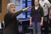 Lawrence Children's Choir director Janeal Krehbiel leads this year's choir in practice for their 20th anniversary concert March 5. Krehbiel, who launched the group with her sister Marilyn Epp in 1991, says that state funding cuts to the arts may dry up 15 percent of the choir's budget.