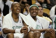Boston Celtics' Ray Allen, left, and Paul Pierce smile on the bench during the fourth quarter of Boston's 112-94 victory over the Orlando Magic in the Eastern Conference semifinals on May 6, 2009, in Boston. Pierce and Allen will be taking part in the three-point shooting contest on Saturday night.