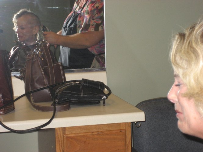 Kim Banning-Bohmann cries as she gets her hair shaved off by a stylist Tuesday, Feb. 15, 2011, in Lawrence. Banning-Bohmann, who has scleroderma, also known as the hardening disease, is undergoing a process to have a stem cell transplant, and that process includes chemotherapy.