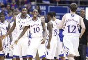 Kansas teammates Tyshawn Taylor (10) and Mario Little wait to applaud Brady Morningstar's effort against Colorado during a timeout in first half on Saturday, Feb. 19, 2011 at Allen Fieldhouse.