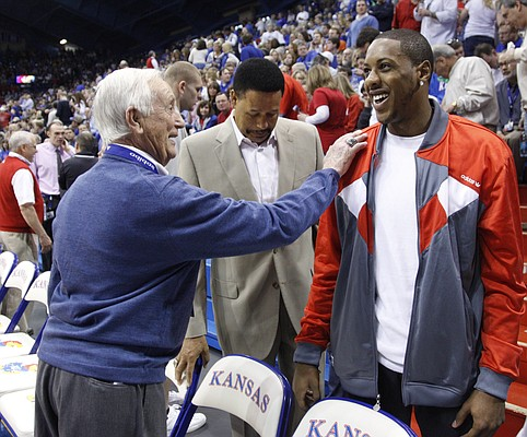 Former Kansas guard and current Miami Heat player Mario Chalmers is greeted by longtime broadcaster Max Falkenstien before tipoff on Saturday, Feb. 19, 2011 at Allen Fieldhouse.