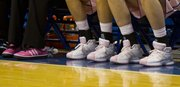 Kansas coaches and players sported pink shoes in honor of cancer awareness during Kansas' game against Missouri Saturday, Feb. 19, 2011 at Allen Fieldhouse. The Jayhawks defeated the Tigers in overtime, 75-70.