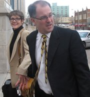 Former Kansas Attorney General Phill Kline and his wife, Deborah, arrive for a hearing before a state panel on a professional ethics complaint against him, Monday, Feb. 21, 2011, in Topeka, Kan. The complaint before a three-member panel of the state Board for Discipline of Attorneys stems from Kline's investigations of abortion providers while in office.