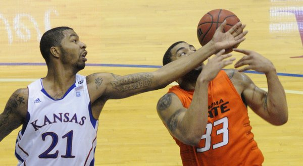 Kansas forward Markieff Morris (21) slaps the ball away from Oklahoma State's Marshall Moses  during the second half Monday, Feb. 21, 2011 at Allen Fieldhouse.