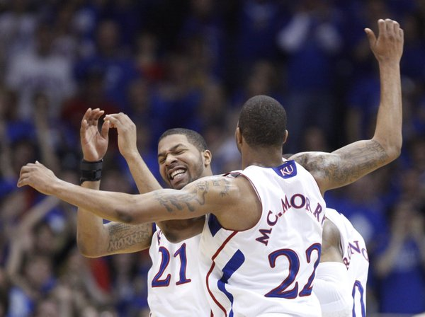 Marcus (22) and Markieff Morris (21) celebrate a blocked dunk by Marcus against Oklahoma State during the first half on Monday, Feb. 21, 2011 at Allen Fieldhouse.