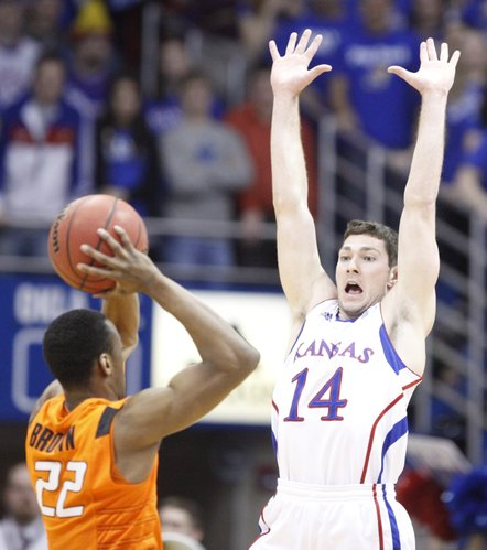 Kansas guard Tyrel Reed defends a pass from Oklahoma State guard Markel Brown during the first half Monday, Feb. 21, 2011 at Allen Fieldhouse.