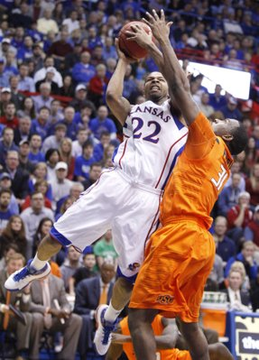 Kansas forward Marcus Morris goes up for a bucket against Oklahoma State forward Matt Pilgrim during the first half on Monday, Feb. 21, 2011 at Allen Fieldhouse.