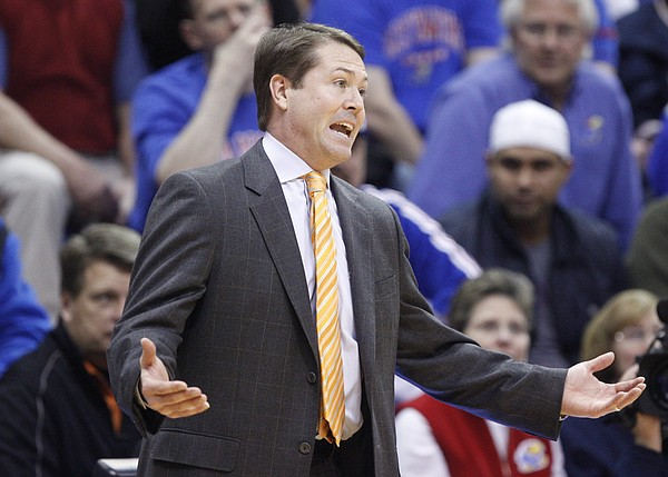 Oklahoma State head coach Travis Ford pleads for a call from an official during the first half on Monday, Feb. 21, 2011 at Allen Fieldhouse.
