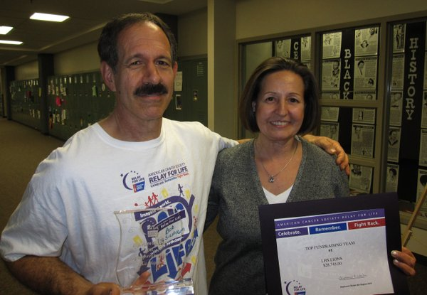 Bob Silipigni and Diane Ash, both of Lawrence, were recognized Tuesday, Feb. 22, 2011, for their Relay For Life of Douglas County fundraising efforts. Their Lawrence High School team raised $28,745 for the American Cancer Society last year, which was the largest amount of the 84 teams that participated.
