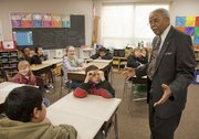Jesse Milan, the first black teacher in Lawrence, talks to a fifth-grade social studies class Wednesday at Prairie Park School, 2711 Kensington Road. Milan talked about his experiences during the days of segregation in Lawrence and how he worked for change.