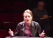 "Liza Pehrson, rehearses a scene from the play ""Opus"" as director Doug Weaver watches in the background."