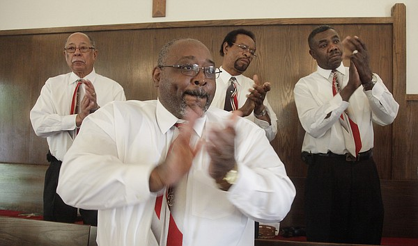 From rear left, Donald Shepard, Aaron Turner, Eugene Hunter and Theodore McVay get into the mood of spiritual song as they for 2011's Black History Month Musical at St. Luke's AME Church, 900 New York St.