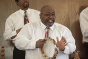 Theodore McVay shakes a tambourine and gets into the mood of a spiritual song as members of St. Luke's AME Church practice for Saturday's black history month musical.