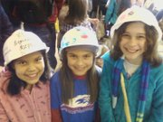 Mariela Martinez, Bella Decker and Olivia Percich — all students at Cordley School — took their smarts up to Kansas University on Friday, Feb. 25, 2011, for the Engineering Expo, where they ran a car made from recycled materials. They also sported hard hats they'd decorated for the occasion.