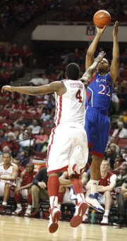 Kansas forward Marcus Morris pulls up for a jumper over Oklahoma forward Andrew Fitzgerald during the first half on Saturday, Feb. 26, 2011 at the Lloyd Noble Center in Norman, Okla.