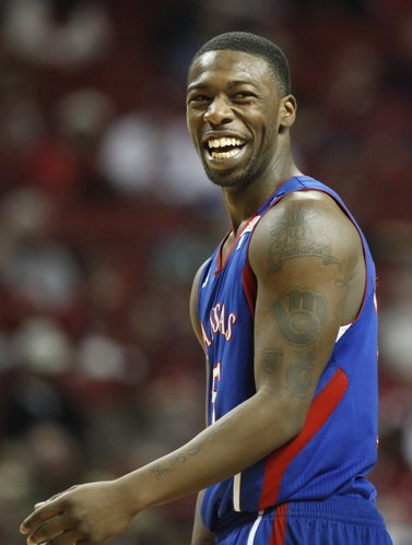Kansas guard Elijah Johnson laughs with his teammates after Oklahoma head coach Jeff Capel was called for a technical foul during the second half on Saturday, Feb. 26, 2011 at the Lloyd Noble Center in Norman, Okla.