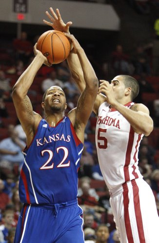 Oklahoma forward C.J. Washington defends Kansas forward Marcus Morris during the second half on Saturday, Feb. 26, 2011 at the Lloyd Noble Center in Norman, Okla.