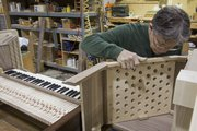 Ed Dorssom works on an organ case assembly at the Reuter Organ Company.  The handcrafted pieces can take as much as three months to complete.