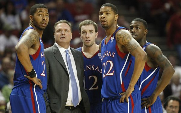 From left, Markieff Morris, coach Bill Self, Brady Morningstar, Marcus Morris and Elijah Johnson look on from the sidelines on Saturday against Oklahoma in Norman, Okla.