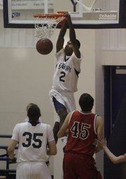 Bishop Seabury freshman Khadre Lane delivers a dunk against White City in the sub-state playoffs at Bishop Seabury on Tuesday, March 1, 2011.