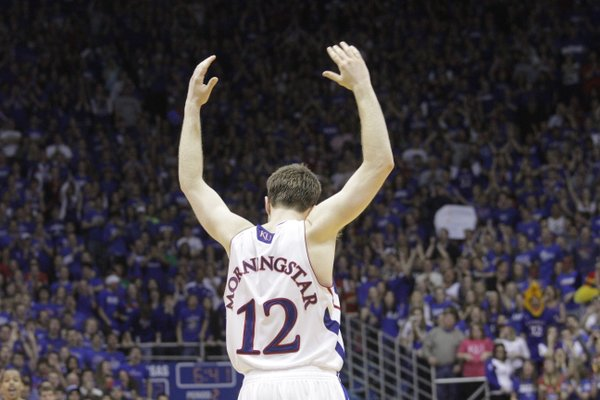 Brady Morningstar (12) celebrates a three-point basket during the Kansas Jayhawks 64-51 win against Texas A&M Wednesday, March 2, 2011. It was the last home game for KU.