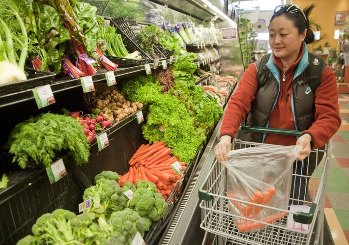 Haining Lou, Lawrence, shops for some vegetables and fruit earlier this month at The Merc. A recently released report ranked Douglas County as the eighth healthiest county in Kansas. One of the measures is access to healthy foods — an area the county is doing well in.
