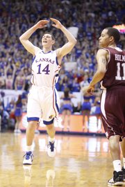 Kansas guard Tyrel Reed gets the Fieldhouse crowd to its feet after hitting a three-pointer to start the game against Texas A&M during the first half on Wednesday, March 2, 2011 at Allen Fieldhouse.