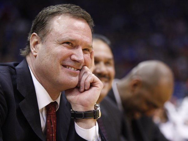 Kansas head coach Bill Self smiles as he listens to forward Mario Little&#39;s senior speech following the Jayhawks&#39; 64-51 win over Texas A&amp;M on Wednesday, March 2, 2011 at Allen Fieldhouse.